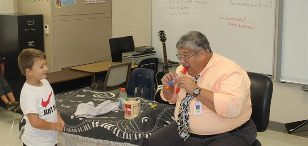 Music teacher works with Elementary Students