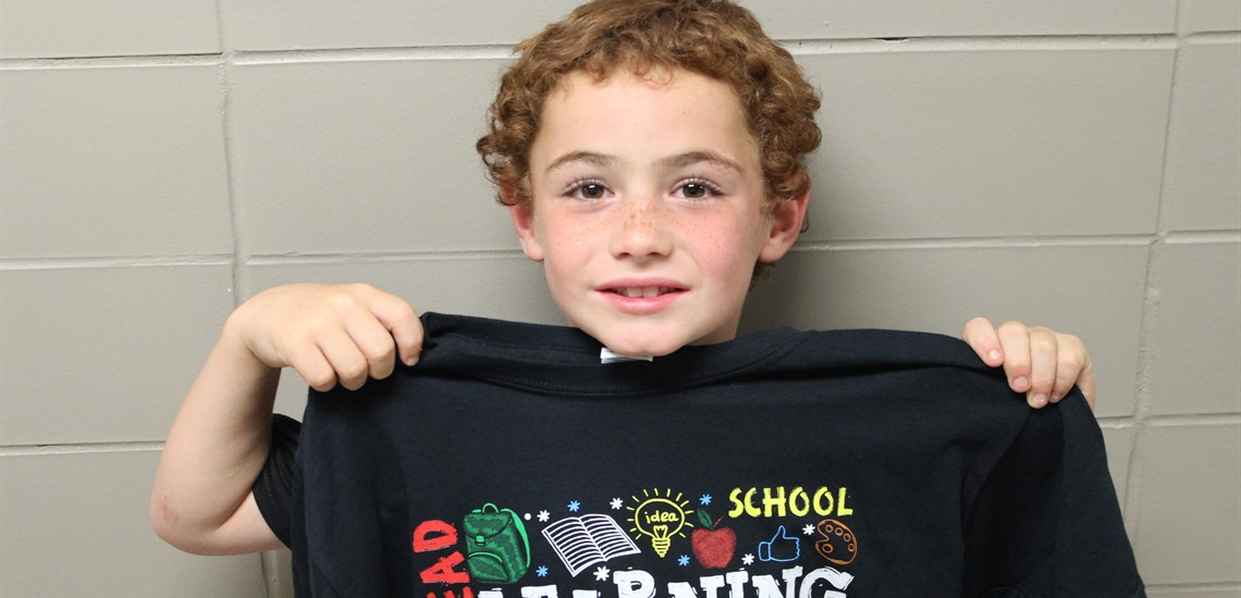 Brian won this cool reading t-shirt by answering Mrs. Carol's question correctly!